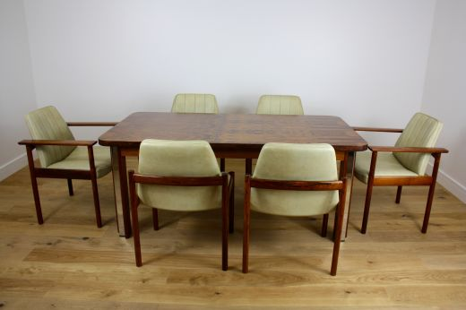 dinning tables MID TWENTIETH CENTURY DESIGN ROSEWOOD DINING TABLE AND CHAIRS (item #1659)