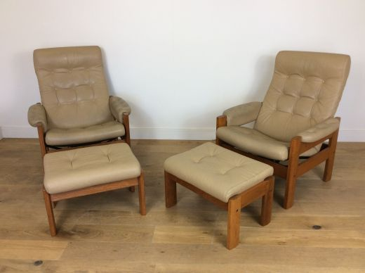 CHAIRS A PAIR OF MID CENTURY RECLINING CHAIRS WITH FOOTSTOOLS (item #1956)